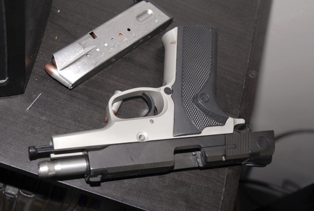 A Smith & Wesson 9-mm pistol on a table in the apartment where Kyle Juhl used it to kill himself in Yakima. The pistol that Juhl used to kill himself was familiar to law enforcement: The Washington State Patrol had seized it years earlier while investigating a crime and then arranged its sale back to the public. It eventually fell into Juhl's hands, illegally.