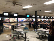 Bowlers applaud during an awards ceremony after the 4A/3A district championships on Wednesday at Crosley Lanes in Vancouver.