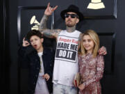 Blink-182 drummer Travis Barker with his children during the arrivals at the 59th Annual Grammy Awards at Staples Center in Los Angeles in 2017.