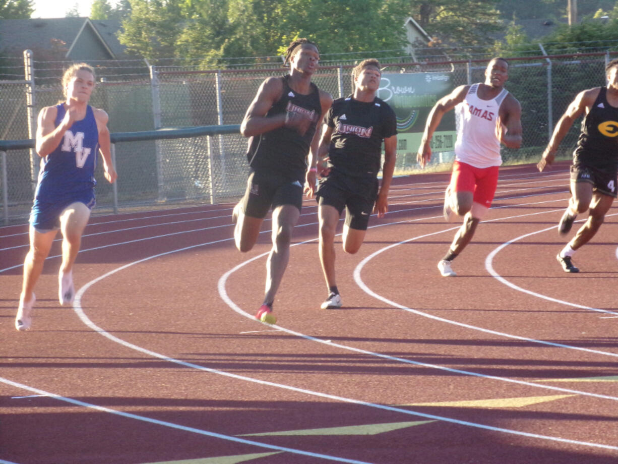 Union's Tobias Merriweather (second from left) races to a win in the boys 200 at the 4A/3A GSHL Invitational track and field meet on Wednesday, June 2, 2021 at McKenzie Stadium (Tim Martinez/The Columbian)