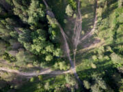 An aerial shot shows eroded roads near Big Rock in the Dishman Hills Conservation area.