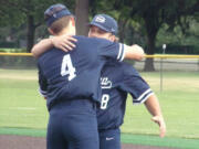Kyle Olson (4) hugs fellow senior Mikey Miller after Skyview's 8-3 win over Prairie in the 4A/3A Greater St.