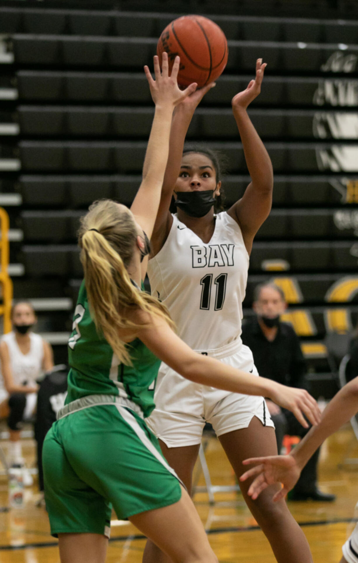 Hudson's Bay forward Jaydia Martin (11) takes a shot while being defended by Tumwater guard Aubrey Amendala (12) during the fourth quarter of the 2A district semi-final game at Hudson's Bay High School on Wednesday, June 9, 2021. Tumwater went on to win by of a score of 61-45.