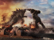 Godzilla battles Kong in Warner Bros. Pictures??? and Legendary Pictures??? action adventure ???Godzilla vs. Kong.??? (Courtesy of Warner Bros.
