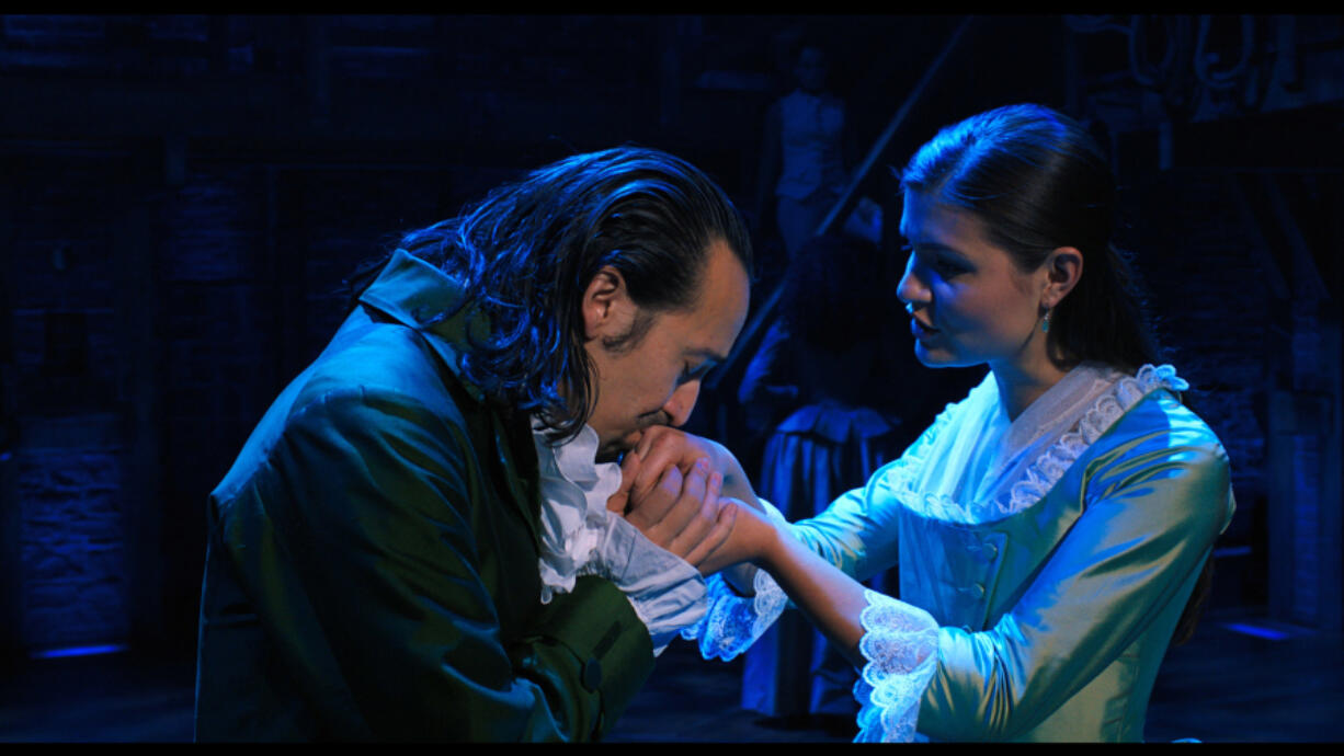 "Lin-Manuel Miranda, left, is Alexander Hamilton and Phillipa Soo is Eliza Hamilton in ""Hamilton,"" the filmed version of the original Broadway production."