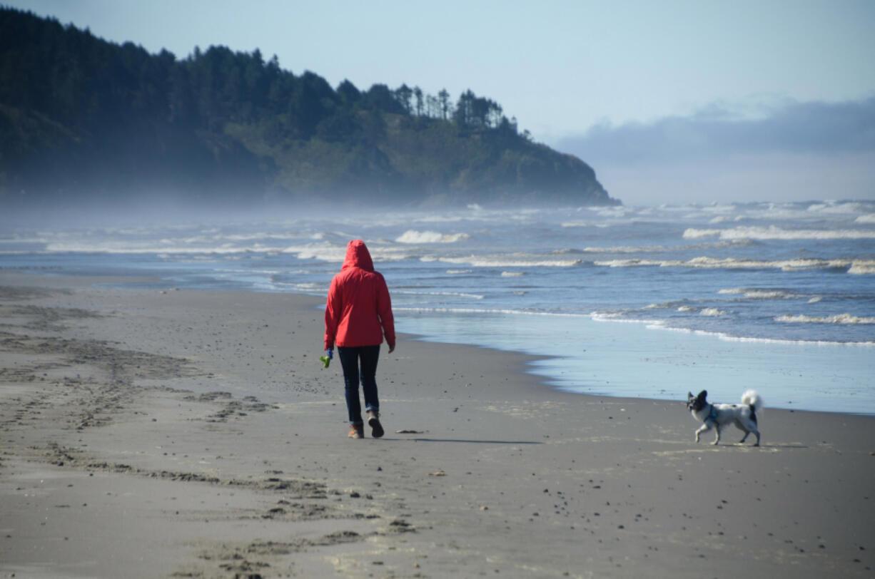 Beachgoers stroll on the sand in Seaview, on Washington's Long Beach peninsula.