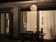 """""""String lights add a touch of warmth to indoor and outdoor spaces,"""" says Erica Stewart, founder of Fashion Fair House Interior Design Development & Investment Firm."""