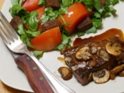 Balsamic-Glazed Steak with Tomato and Watercress Salad (Linda Gassenheimer/TNS)