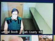Presley Mileck, 50, makes a first appearance Wednesday in Clark County Superior Court on suspicion of first-degree murder. Mileck is accused of fatally shooting a neighbor, who was apparently loudly revving his engine.