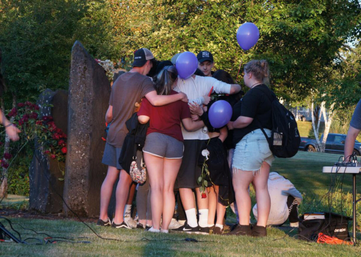 Community members gather at Estacada High School for a candlelight vigil June 2, 2021 to mourn the loss of three teenagers in a Memorial Day car crash.