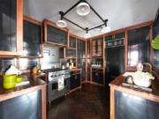 Black cabinets trimmed in walnut make an elegant statement in this kitchen.