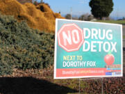 """A """"No Drug Detox Next to Dorothy Fox"""" sign stands at the corner of Northwest 28th Avenue and Northwest Utah Street, across from the Camas elementary school, on March 16."""