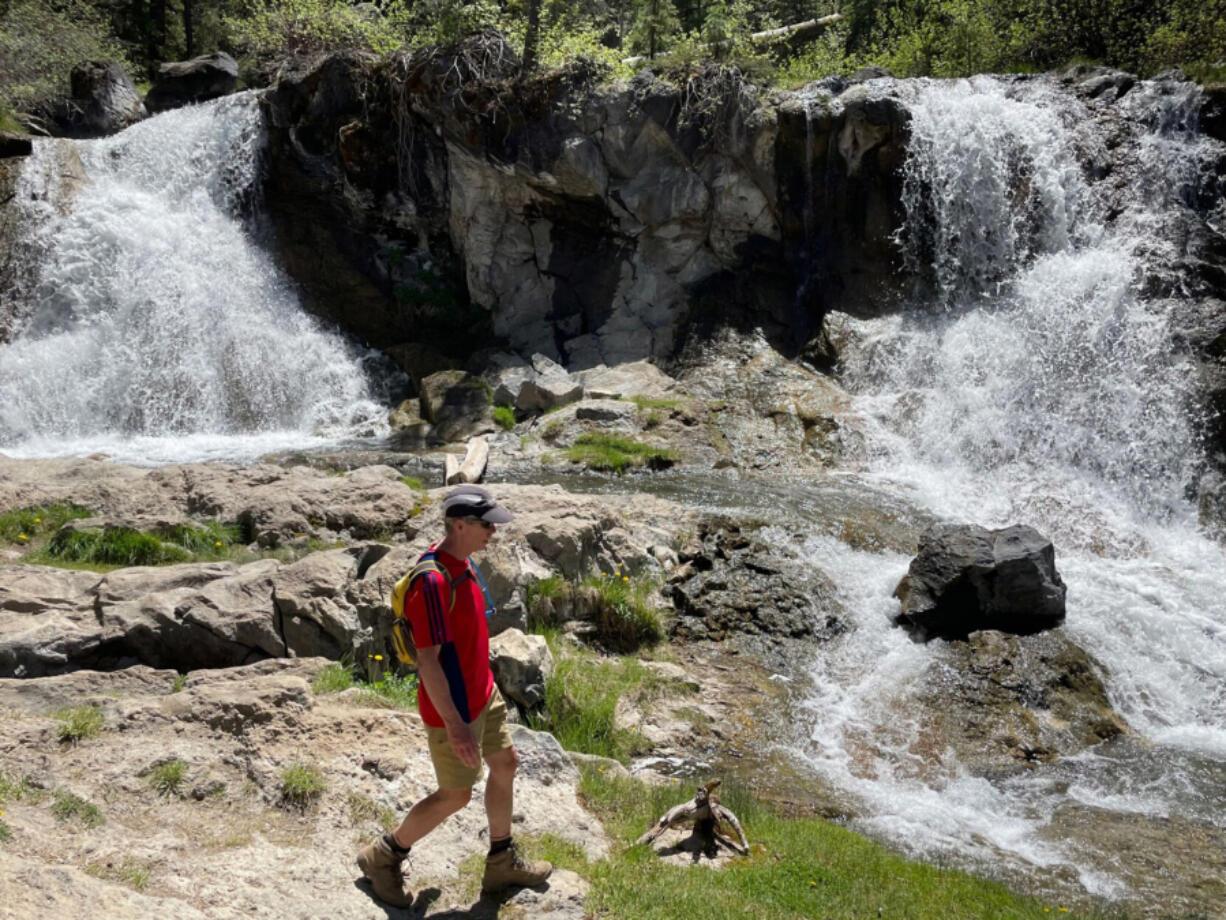 Bend???s Mark Johnson takes in the scenery near a double waterfall along Paulina Creek.