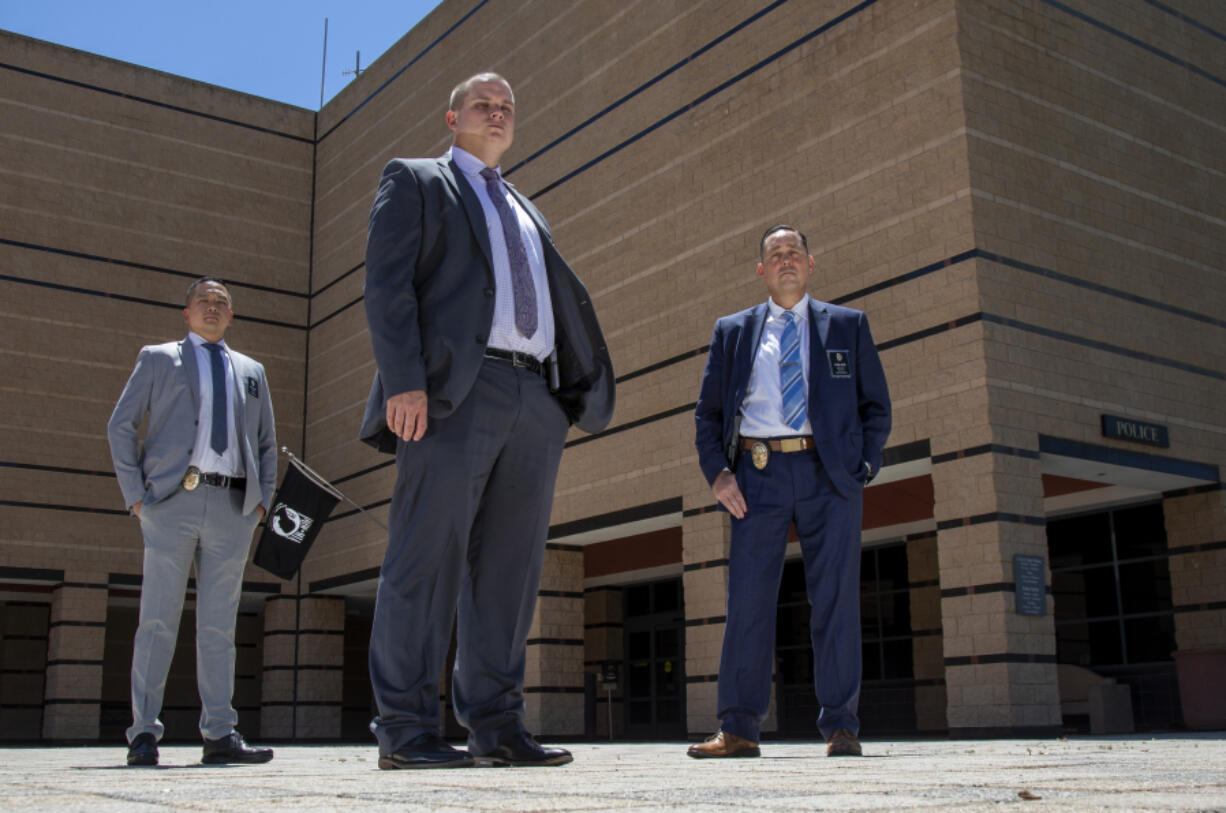 Irvine Police Detectives Victor Chang left, Haldor Larum, middle, and Gavin Hudson, right, are investigating the mysterious disappearance of Amber Aiaz and her daughter Melissa Fu from their Irvine apartment on June 11, 2021, in Irvine, California. The two disappeared in late 2019.