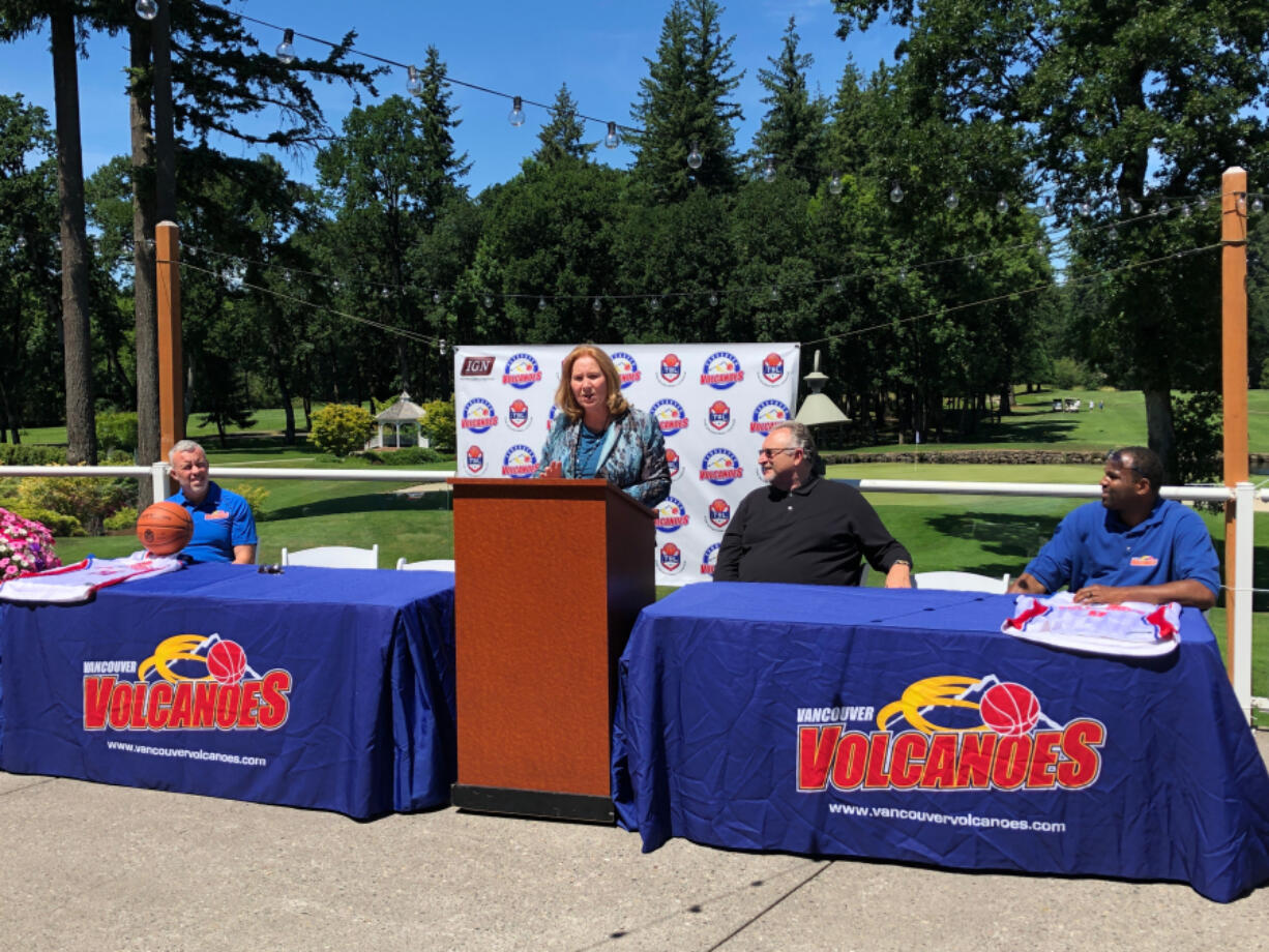Vancouver Mayor Anne McEnerny-Ogle speaks during an event to celebrate the return of the Vancouver Volcanoes basketball franchise on Thursday at Camas Meadows Golf Course. She was joined by, from left, Volcanoes general manager Jeff Perrault, The Basketball League president Dave Magley and Volcanoes owner Curtis Hill.