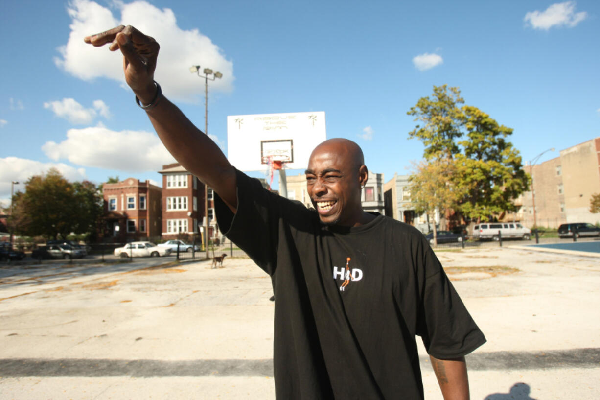 """Arthur Agee, one of the stars of the movie """"Hoop Dreams,"""" waves to an old friend in 2008 in Chicago."""