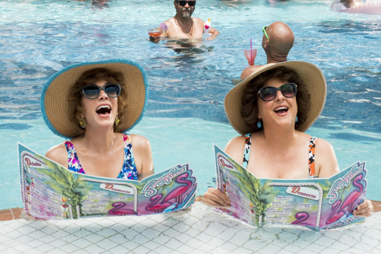 """Kristen Wiig, right, as Star and Annie Mumolo as Barb perform in """"Barb and Star Go to Vista Del Mar."""" (Cate Cameron/Lionsgate)"""
