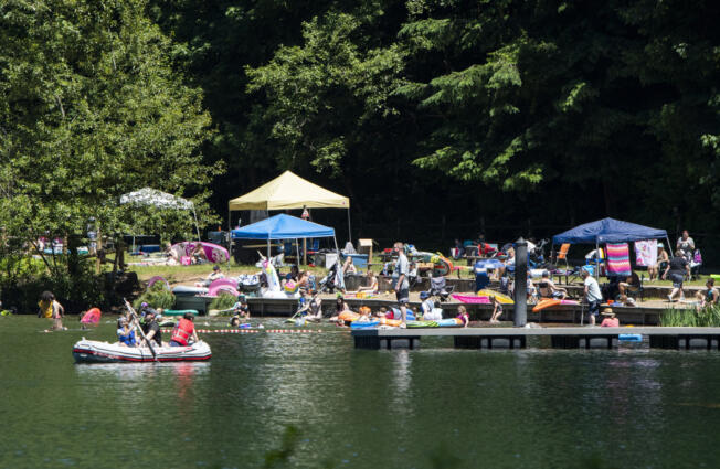 A crowd soaks up the sunshine on the shores of Battle Ground Lake on Saturday at Battle Ground Lake State Park.