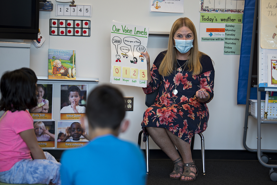 Kindergarten teacher Pam Younkin guides students on the appropriate voice levels for the classroom at Sifton Elementary School in September. Evergreen will expand summer school offerings to students in all grades, including 1,800 elementary students signed up for June and August summer school.