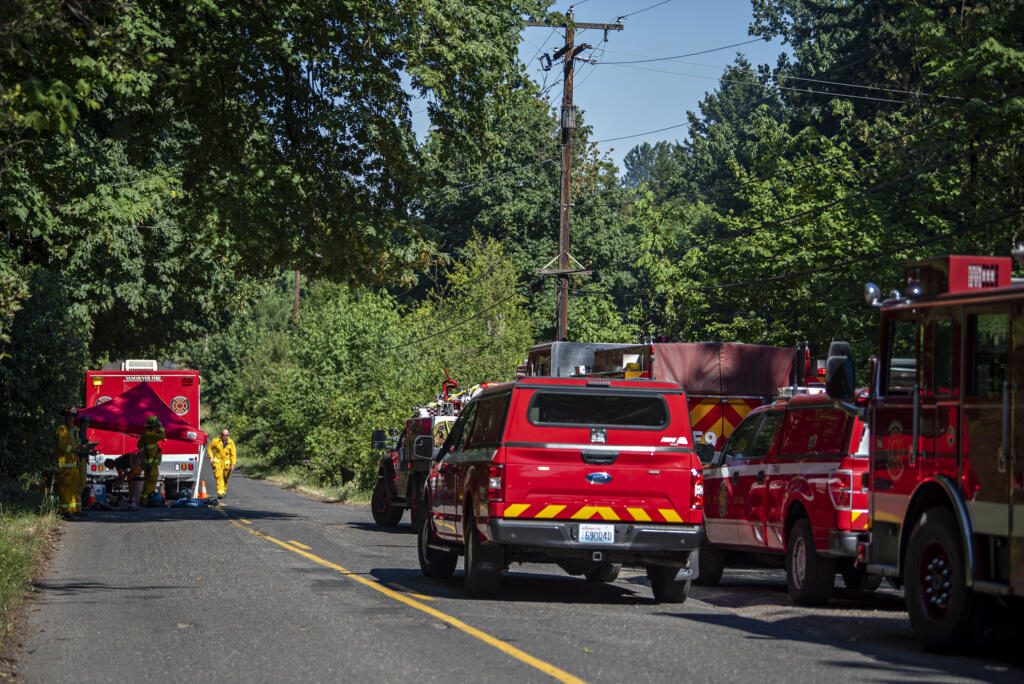 Firefighters respond to a two-alarm fire at a large house on Evergreen Highway.on Monday afternoon, June 28, 2021.