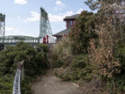 The current boardwalk ends at a locked gate and shrubbery behind Who Song and Larry's.(Joshua Hart/The Columbian)