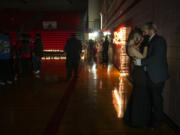 A couple finds some space to themselves while slow dancing during the Fort Vancouver High School prom on May 22. Due to COVID-19, participants had to wear masks and have their temperature checked upon arrival as well as fill out a health screening form.