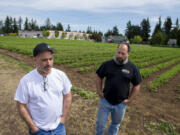 Scott Beaudoin, left, and Mike Beaudoin talk about the future of strawberries at Joe's Place Farms. Although the farm store is no longer open, the brothers are carrying on with a U-pick operation.