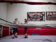 Suzanne Haidri, left, goes through a series of exercises with the help of trainer Jan Beyer at Fisticuffs Gym in Vancouver. Haidri has Parkinson's disease, and boxing has helped improve her strength, speed and balance.
