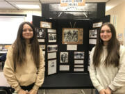 BATTLE GROUND: Pleasant Valley Middle School students Kristina Goldinov (left) and Abby Dubinskiy pose with their National History Day exhibit on the march from Selma to Montgomery, Ala.