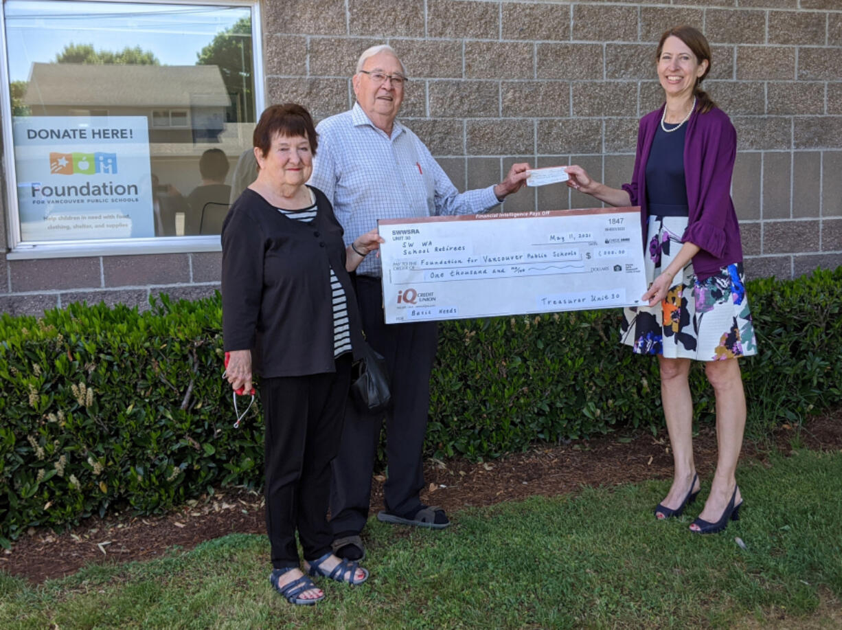 CLARK COUNTY: Marty Erickson and Linda Bannon from Southwest Washington School Retirees' Association presented Nada Wheelock from the Foundation for Vancouver Public Schools a check for $1,000.