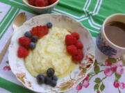 Cooked with milk, butter and honey, sweet grits are a hearty breakfast with fresh berries and a sprinkle of cinnamon.