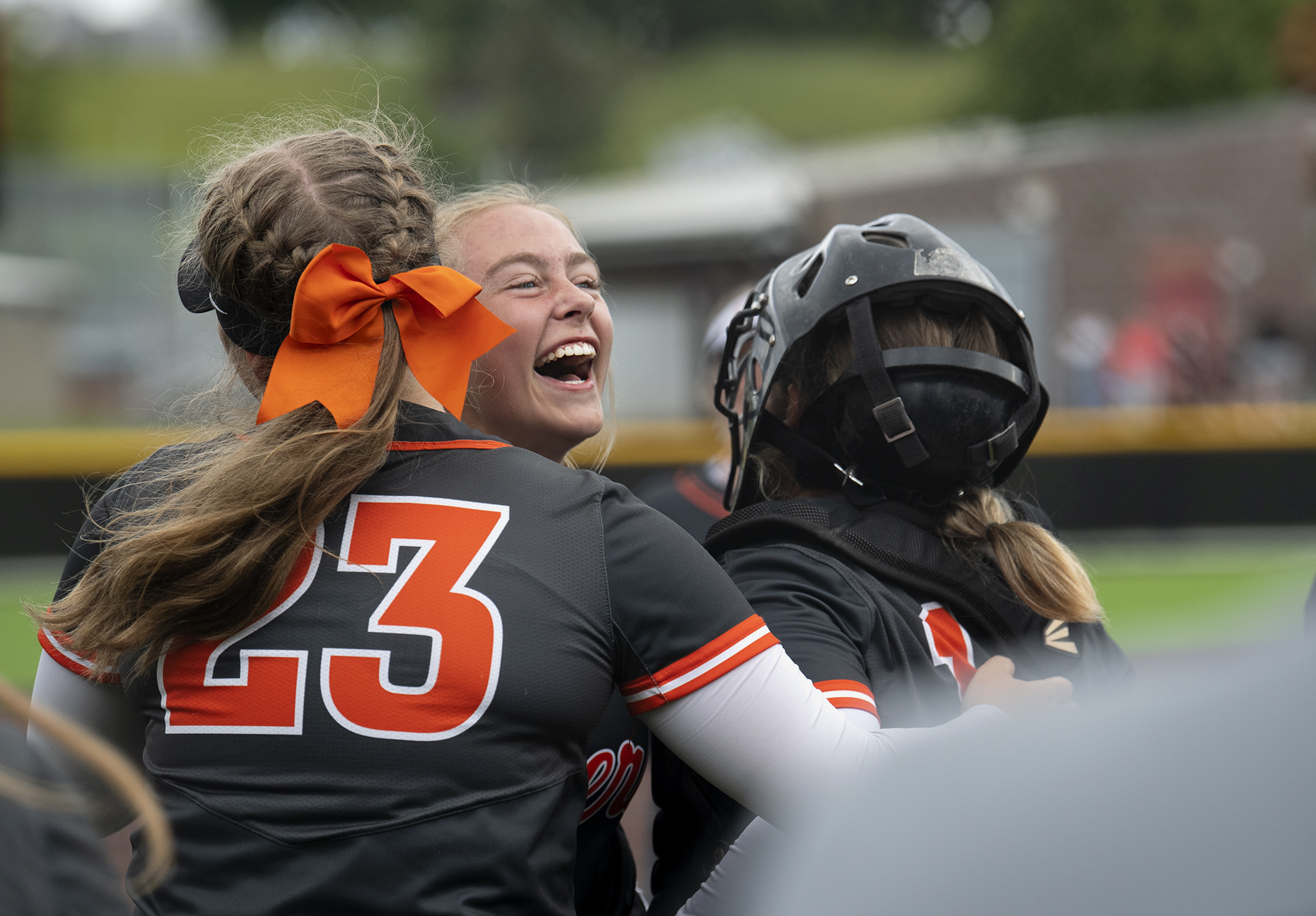 From left, Liv Gruenberg, Ryee Rehbein and Alexis Laizure hug after winning the 4A/3A Greater St. Helens League district championship game on Saturday, June 5, 2021, at Camas High School. Battle Ground defeated Mountain View 8-0 to take the title.