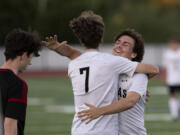 Camas senior Ethan Jud, facing, gives Hayden Rouse a hug after Rouse scored the final goal in the Papermakers' 6-0 rout of Union on Thursday, June 3, at Union High School. The Papermakers sealed the 4A/3A Greater St.