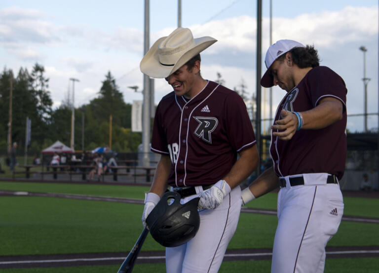 Ridgefield's Koby Darcy gets a cowboy hat and a pat on the butt from Coby Morales after hitting a solo home run in the second inning of a West Coast League baseball game on Tuesday, June 8, 2021, at the Ridgefield Outdoor Recration Complex. Ridgefield won 6-3 to improve to 4-0 on the season.