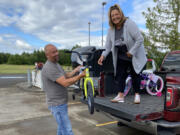 RIDGEFIELD: The Police Activities League of Southwest Washington partnered with Waste Connections to give 21 local children a bike and helmet for the start of summer.
