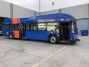 One of TriMet's new battery-electric buses from manufacturer Gillig sits outside a garage in March. C-Tran's board of directors voted Tuesday to authorize the purchase of eight buses of the same model to begin running in Clark County. The buses charge overnight and have an estimated range of 150-210 miles per charge.