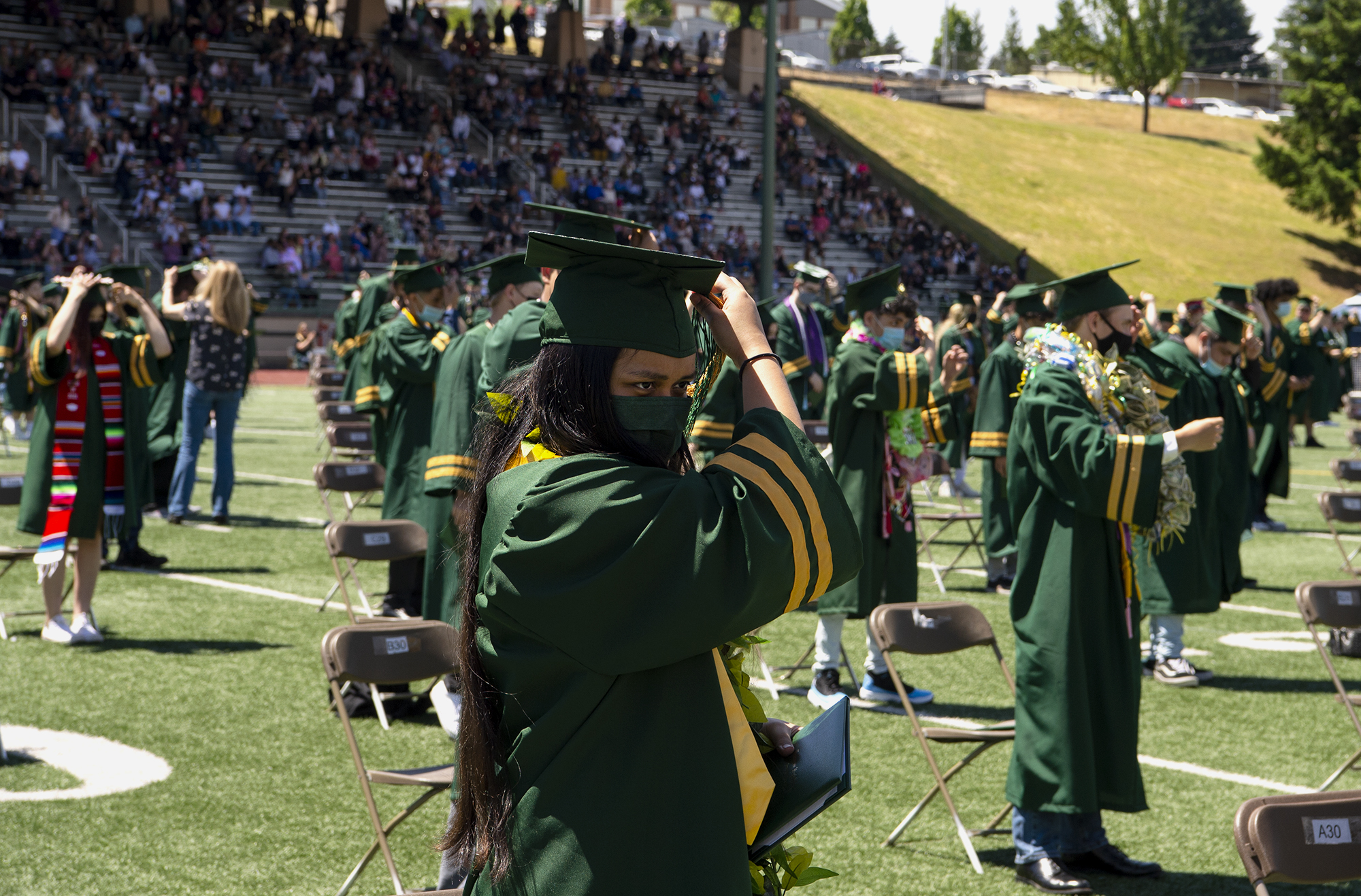 ASB treasurer Sirak Yohannes flips her tassle from the right to left to signify her graduation at the Evergreen High School graduation ceremony on Saturday, June 12, at McKenzie Stadium.