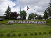 """For the second year in a row, the """"Welcome to Washington"""" display along Interstate 5 has not been replanted due to the COVID-19 pandemic. The garden is normally replanted with flowers each spring by volunteers from the Washington State University Extension Master Gardener program."""