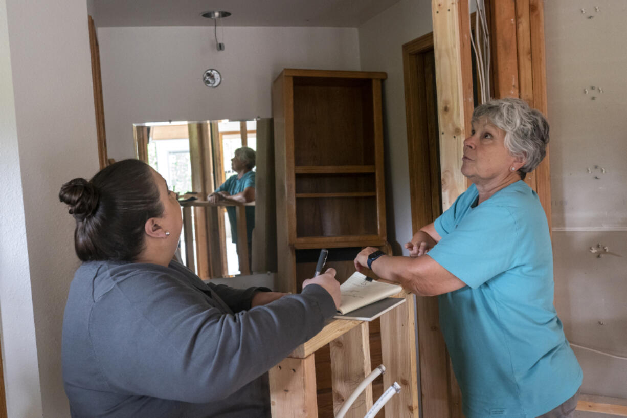 """Elizabeth Gomez, owner of Bridge City Contracting, left, talks with Judie Stanton, a former Clark County commissioner, about her bathroom remodel. Gomez has an Aging-in-Place Specialist certification through the National Association of  Home Builders. She's helping Stanton design her home to accommodate needs she may have in the future as she ages. """"Typically what happens is people will wait until an event happens like a stroke when they start thinking about modifications to their home,"""" Gomez said."""