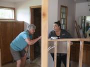 Judie Stanton, left, talks with Elizabeth Gomez, owner of Bridge City Contracting, about her bathroom remodel.