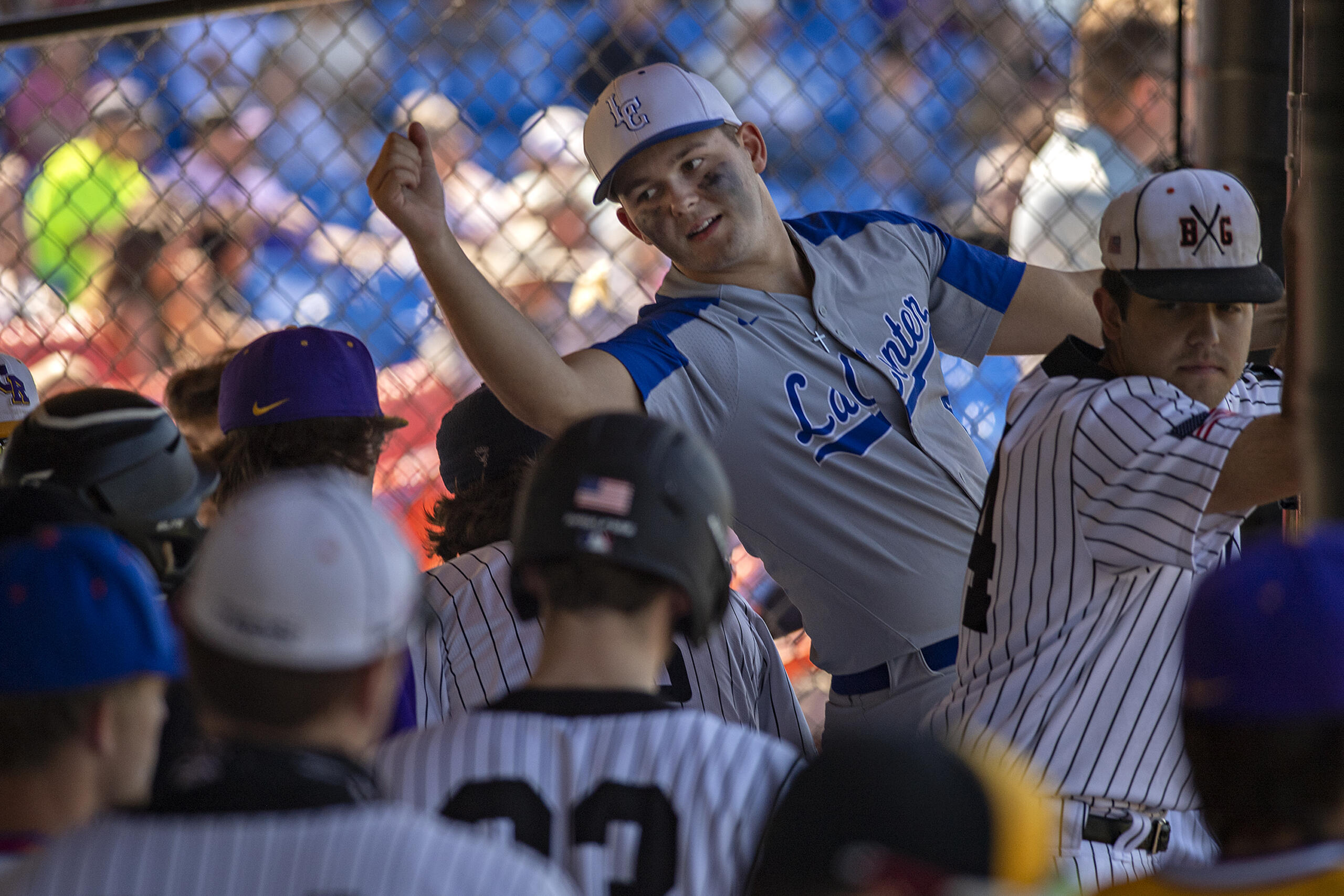 La Center's Tom Lambert, facing, stretches to congratulate an American League teammate after they scored in the first inning during the Senior All-Star Game at Ridgefield Outdoor Recreation Center on Wednesday afternoon, June 16, 2021.