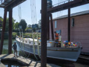 Rick Bishoprick, left, who spent more than 25 years taking the lead on restoring his family's wooden boat, Corahleen, in Washougal and Ridgefield, talks with Loren Decker of Schooner Creek on Hayden Island on Monday morning.