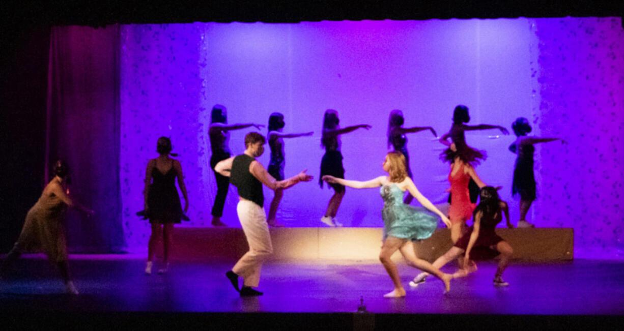 BATTLE GROUND: Prairie High School students David Hatcher and Carson Verity dance during an ensemble production.