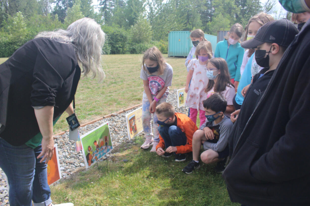 RIDGEFIELD: The class read the story with South Ridge Elementary School librarian Emily Crawford by following the pages posted along the path.