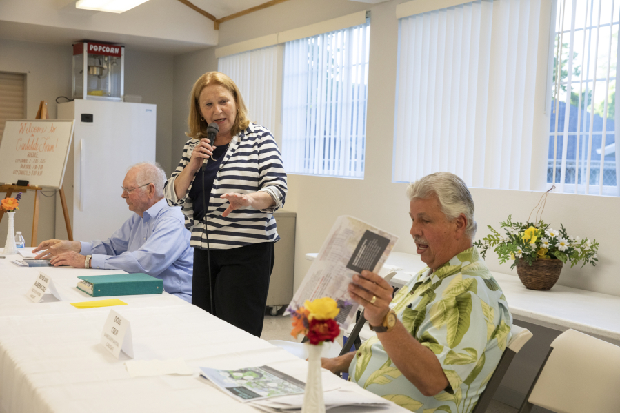 Vancouver Mayor Anne McEnerny-Ogle, center, responds to comments from her challengers, Earl Bowerman, left, and Doug Coop, right, at a candidates forum in June.