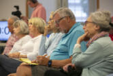 Ken Wilkinson, second from right, takes notes during a candidate forum at Trinity Baptist Church in Vancouver on Tuesday.