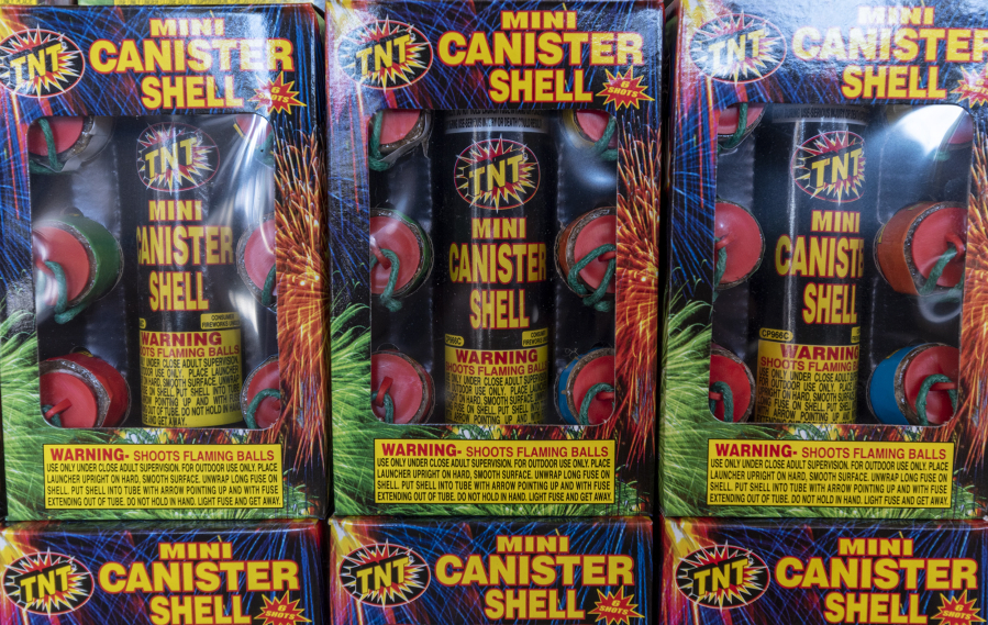 "Boxes of ""Mini Canister Shell"" fireworks sit on shelves inside TNT Fireworks Warehouse."