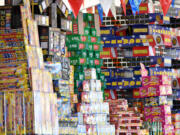 Stacks of fireworks sit atop shelves Thursday at the TNT Fireworks Warehouse in Hazel Dell. Clark County banned the use and sale of fireworks effective Tuesday.