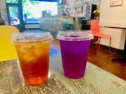 Iced orange passion fruit jasmine tea and butterfly pea flower tea with lemon juice at Dandelion Teahouse.