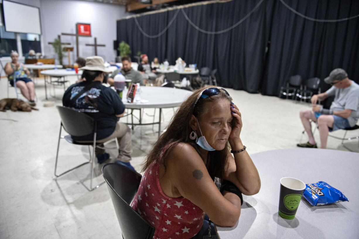 """Tracy Jones of Vancouver joins a crowd of local residents at the Living Hope Church cooling center as she escapes the extreme heat on Monday afternoon. The church offered fans, cold drinks, popsicles and snacks. """"I'm glad they have something like this. It's rough out there,"""" she said."""